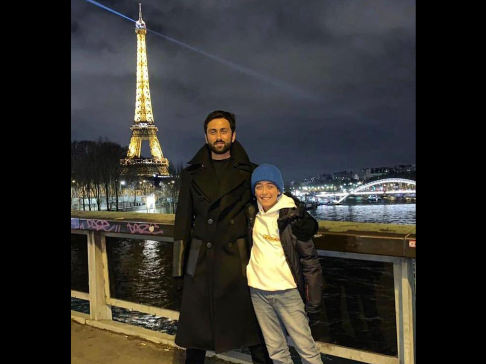 My eldest and my youngest, next to the beautiful lights of the Eiffel Tower
